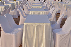Tables and chairs with white clothes. Stock Photography