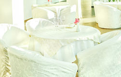 Tables and chairs in white Stock Images