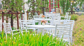 Tables, chairs, white outdoor patio Stock Photography