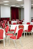 Tables and chairs. A white tables and red modern chairs Stock Photography