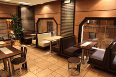 Tables, chairs and windows in small restaurant. In Rome, Italy stock photography
