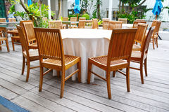 Tables and chairs wooden in the hotel. Stock Image