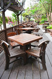 Tables and chairs wooden in the restaurant. Stock Image