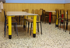 Tables and colored chairs in a nursery school Royalty Free Stock Image