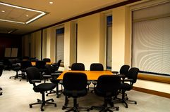 Tables in Conference Room. Individual tables set up for management discussion groups in a large modern office building conference room Stock Images