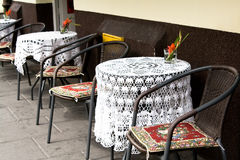 Tables with crocheted tablecloths at an outdoor cafe, Krakow,  Europe. Stock Images