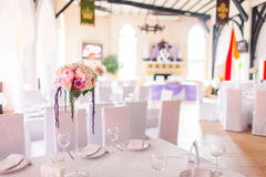 Tables decorated with flowers Stock Photo