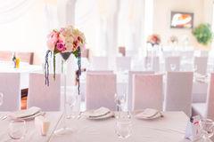 Tables decorated with flowers Royalty Free Stock Image
