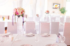 Tables decorated with flowers Stock Photos