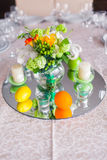Tables decorated with flowers and fruit Stock Image