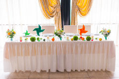 Tables decorated with flowers and fruit Royalty Free Stock Photo