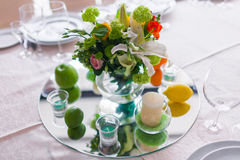 Tables decorated with flowers and fruit Stock Photos