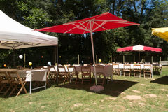 Tables and decoration prepared for an outdoor party Royalty Free Stock Photos