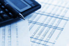 Tables of figures. Calculator with pen on financial data Stock Images