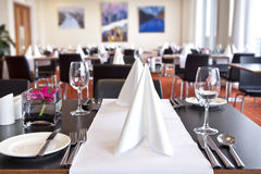 Tables with formal setup in modern restaurant Royalty Free Stock Image