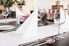 Tables with formal setup in modern restaurant Royalty Free Stock Images