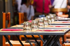 Tables with glasses at an outdoor cafe Royalty Free Stock Images