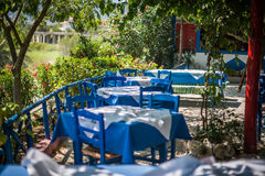 Tables in Greek traditional tavern on the street. In Zakynthos, Greece Royalty Free Stock Photos