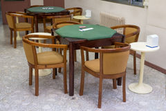 Tables with green cloth for card games Royalty Free Stock Photography