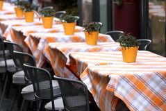 Tables laid with checkered tablecloth for a stylish Italian rest Royalty Free Stock Photos
