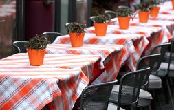 Tables laid with checkered tablecloth for a stylish restaurant Royalty Free Stock Images
