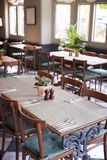 Tables Laid For Service In Empty Restaurant stock photo