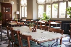 Tables Laid For Service In Empty Restaurant royalty free stock photo