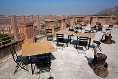 Tables of morning empty restaurant on the top of indian fortress Stock Photography