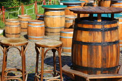 Tables old barrels. Medieval tavern with old barrels dining and chairs stock photography