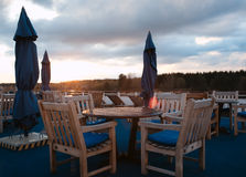 Tables in outdoor bar on stern of cruise liner Royalty Free Stock Image