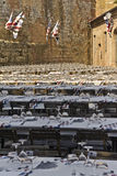 "Tables for outdoor dinner of the day before Palio. Long tables set up in a square for the dinner that Istrice neighborhood (""contrada"") people usually have Royalty Free Stock Images"