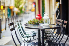 Tables of a Parisian cafe decorated for Christmas Stock Photography
