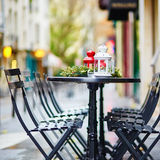 Tables of a Parisian cafe decorated for Christmas Stock Image