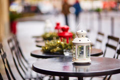 Tables of a Parisian cafe decorated for Christmas Stock Images