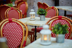 Tables of a Parisian outdoor cafe Stock Photos