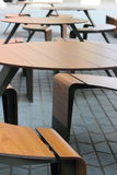 Tables on the pavement in a row Stock Photo