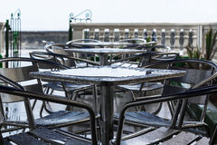 Tables in the rain Royalty Free Stock Images