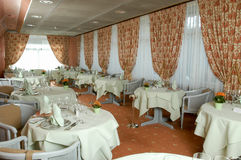 Tables ready for dinner on a restaurant at Leukerbad Stock Photography