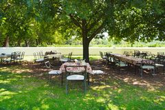 Wine tasting areal in courtyard of winery, South Africa. Tables ready for wine tasting in winery, South Africa stock image