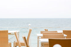 Tables at a restaurant. Overlooking sea views Stock Photos