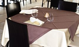 Tables at the restaurant. Tables backgrounds set in the restaurant waiting for customers Royalty Free Stock Image