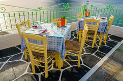 Tables at restaurant with national Greek colors Royalty Free Stock Photo