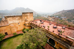 Tables in a restaurant on the roof of the Amber Fort. Stock Photo