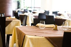 Tables at the restaurant. Tables backgrounds set in the restaurant waiting for customers Royalty Free Stock Photo