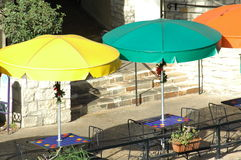 Tables on the River Walk. Table with colorful umbrellas on the river walk of San Antonio, Texas Stock Image