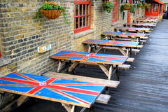 Tables. Row of wooden tables with painted Union Jack flag in Camden Town Market, London royalty free stock photography