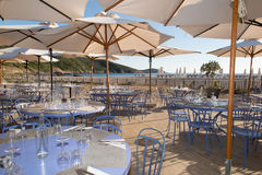 Tables at seaside restaurant with beautiful view Stock Photos