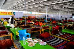 Tables seats man and charpoys and staff at Moon restaurant Naran Kaghan Pakistan Royalty Free Stock Photography