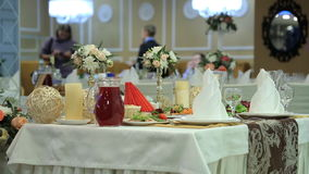Tables are served for celebrating event in banquet hall. stock video