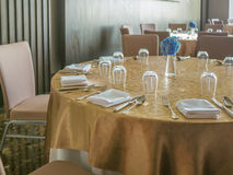 Tables set for dinner. In hotel Stock Photography